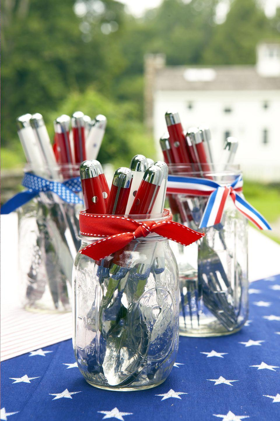 <p>Help guests move through the buffet line quickly with grab-and-go silverware in decorated Mason jars. Just tie ribbon remnants on a trio of vases and fill with reusable flatware. </p>