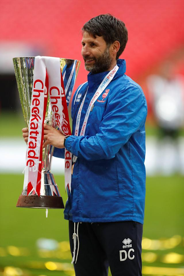 "Soccer Football - Checkatrade Trophy Final - Lincoln City vs Shrewsbury Town - Wembley Stadium, London, Britain - April 8, 2018 Lincoln City manager Danny Cowley celebrates with the trophy after winning the Checkatrade Trophy Final Action Images/Matthew Childs EDITORIAL USE ONLY. No use with unauthorized audio, video, data, fixture lists, club/league logos or ""live"" services. Online in-match use limited to 75 images, no video emulation. No use in betting, games or single club/league/player publications. Please contact your account representative for further details."