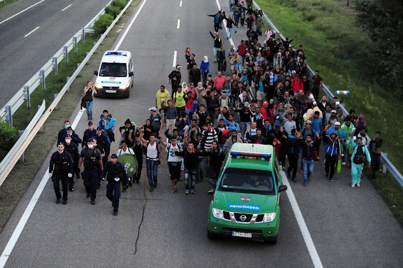 Migrants walk along the M5 highway in Hungary heading for Budapest, after breaking out from a collection point near Roszke on September 7, 2015