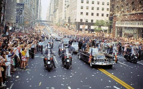 Aldrin, Collins and Armstrong wave to the crowds from an open-top car during the New York parade - Credit: GETTY IMAGES