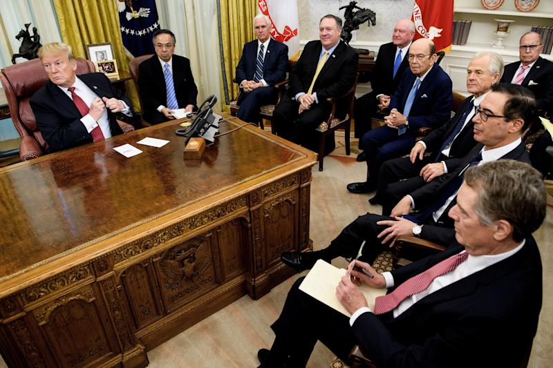 US President Donald Trump (L) waits with US Vice President Mike Pence (3L), US Secretary of State Mike Pompeo (4L), US Secretary of Agriculture Sonny Perdue (5L), US Secretary of Commerce Wilbur Ross (5R), Peter Navarro (4R), US Trade Representative Robert Lighthizer (3R), US Secretary of the Treasury Steven Mnuchin (2R), National Economic Council Director Larry Kudlow (R) and others for a meeting with China's Vice Premier Liu He and other Chinese officials in the Oval Office of the White House January 31, 2019 in Washington, DC. (Photo by Brendan Smialowski / AFP) (Photo credit should read BRENDAN SMIALOWSKI/AFP/Getty Images)