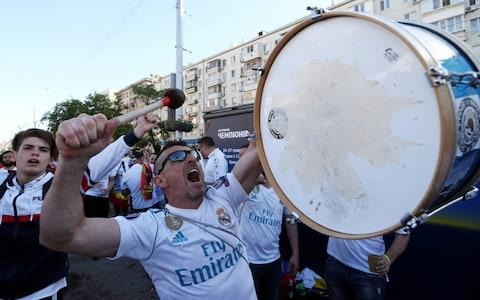 A Real Madrid fans bangs the drum - Credit:  REUTERS/Viacheslav Ratynskyi