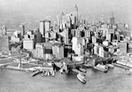 <p>An aerial view of the New York City Skyline in 1922. At this time, the tallest building in the city was the Woolworth Building (back center) and the city's ports were heavily used. </p>