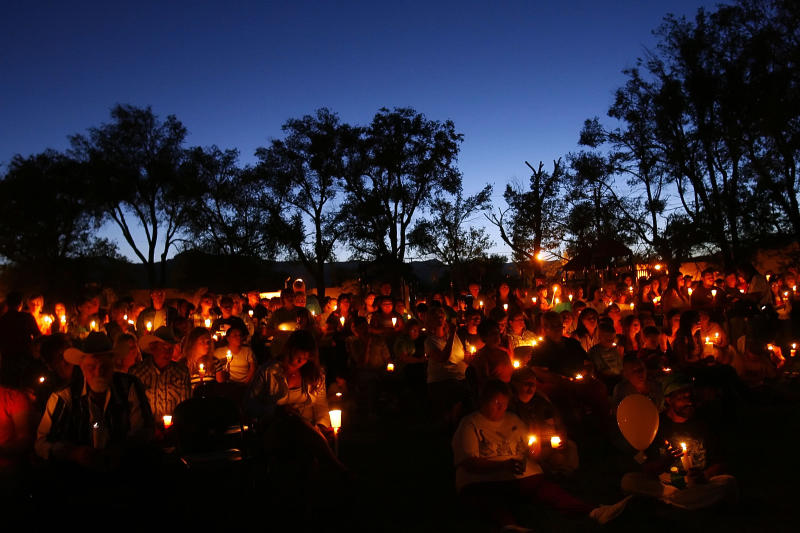 FILE - This Aug. 10, 2007 file photo shows more than 200 people attending a candlelight vigil near Huntington, Utah, for miners trapped in the collapse at Crandall Canyon Mine. The operator of the Crandall Canyon mine agreed on Friday March 9, 2012, to plead guilty to two misdemeanor criminal charges and pay a $500,000 fine. (AP Photo/The Salt Lake Tribune, Chris Detrick) DESERET NEWS OUT; LOCAL TV OUT