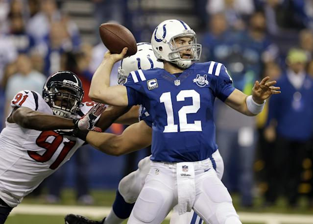 Indianapolis Colts quarterback Andrew Luck (12) throws under pressure from Houston Texans linebacker Ricky Sapp during the first half of an NFL football game in Indianapolis, Sunday, Dec. 15, 2013. (AP Photo/Darron Cummings)