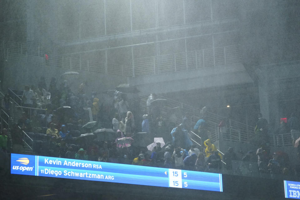 Sep 1, 2021; Flushing, NY, USA; Rain falls into Louis Armstrong Stadium from the openings along the side as Diego Schwartzman of Argentina faces Kevin Anderson of South Africa on day three of the 2021 U.S. Open tennis tournament at USTA Billie Jean King National Tennis Center. Mandatory Credit: Danielle Parhizkaran-USA TODAY Sports