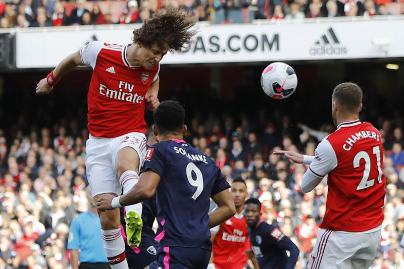 Asenal's Brazilian defender David Luiz (L) jumps to head home the opening goal of the English Premier League football match between Arsenal and Bournemouth at the Emirates Stadium in London on October 6, 2019. (Photo by Tolga AKMEN / AFP) / RESTRICTED TO EDITORIAL USE. No use with unauthorized audio, video, data, fixture lists, club/league logos or 'live' services. Online in-match use limited to 120 images. An additional 40 images may be used in extra time. No video emulation. Social media in-match use limited to 120 images. An additional 40 images may be used in extra time. No use in betting publications, games or single club/league/player publications. / (Photo by TOLGA AKMEN/AFP via Getty Images)