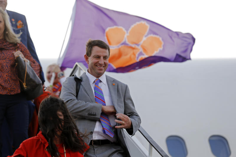 Clemson head coach Dabo Swinney and his wife Kathleen Swinney, bottom left, arrive with the team for the NCAA College Football Playoff national championship in New Orleans, Friday, Jan. 10, 2020. Clemson is to play LSU on Monday. (AP Photo/Gerald Herbert) (AP Photo/Gerald Herbert)