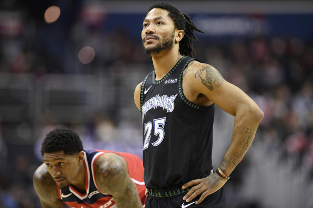 Minnesota Timberwolves guard Derrick Rose (25) stands on the court next to Washington Wizards guard Bradley Beal, left, during the second half of an NBA basketball game, Sunday, March 3, 2019, in Washington. The Wizards won 135-121. (AP Photo/Nick Wass)