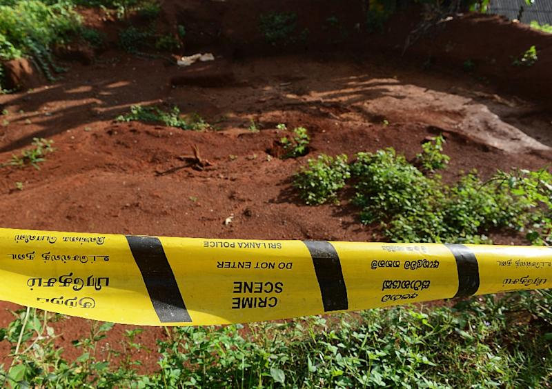 A police cordon pictured at a mass grave that was unearthed in Matale, Sri Lanka, in 2013 (AFP Photo/Ishara S. Kodikara)