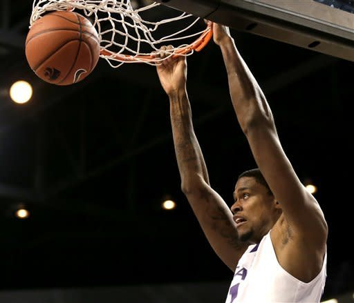 Kansas State forward Jordan Henriquez dunks during the first half of an NCAA college basketball game against Texas Southern on Tuesday, Dec. 18, 2012, in Manhattan, Kan. (AP Photo/Charlie Riedel)