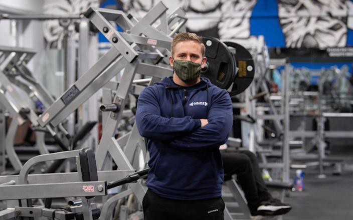 Alex Lowndes, owner of Gainz Fitness in Bedford, said he felt a 'moral obligation' to break the rules - Joe Giddens/PA