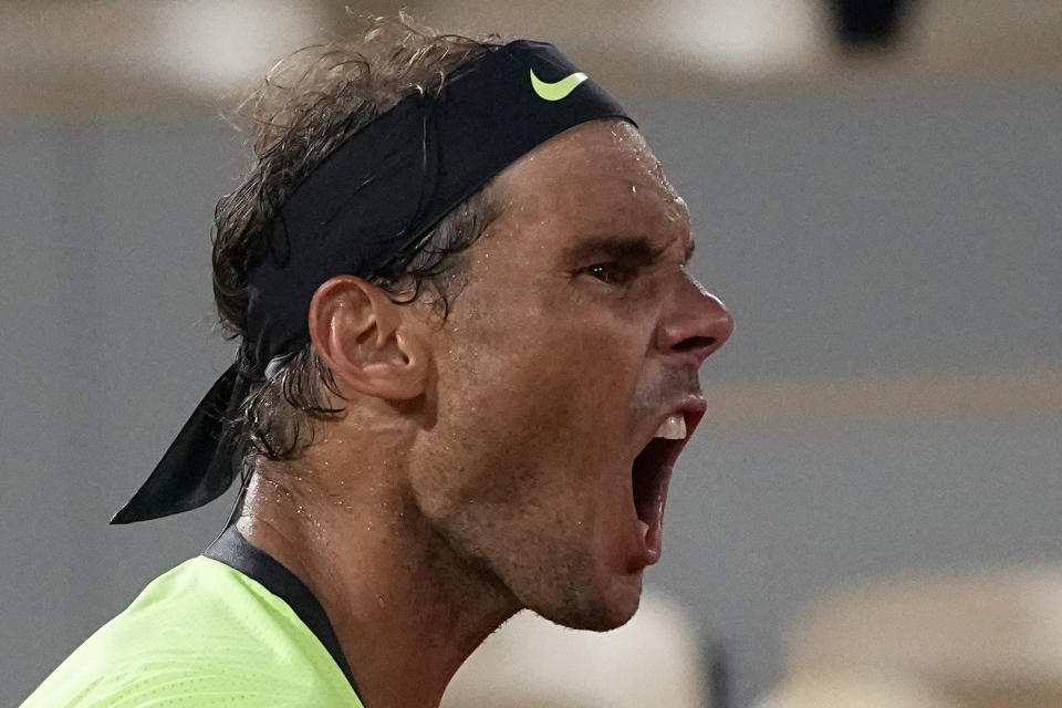 Spain's Rafael Nadal shouts as he plays Serbia's Novak Djokovic during their semifinal match of the French Open tennis tournament at the Roland Garros stadium Friday, June 11, 2021 in Paris. (AP Photo/Michel Euler)
