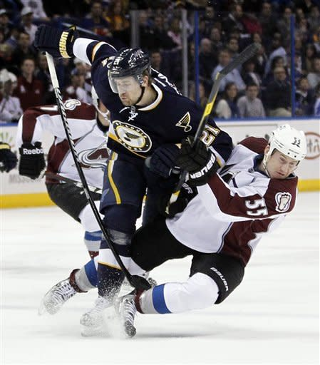 St. Louis Blues' Patrik Berglund, of Sweden, and Colorado Avalanche's Cody McLeod, right, collide during the third period of an NHL hockey game Saturday, Jan. 7, 2012, in St. Louis. The Blues won 4-0. (AP Photo/Jeff Roberson)
