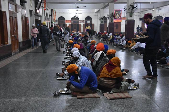 "<span class=""caption"">A community kitchen run by the Sikhs to provide free meals irrespective of caste, faith or religion, in the Golden Temple, in Punjab, India.</span> <span class=""attribution""><a class=""link rapid-noclick-resp"" href=""https://www.flickr.com/photos/shankaronline/38938496121"" rel=""nofollow noopener"" target=""_blank"" data-ylk=""slk:shankar s."">shankar s.</a>, <a class=""link rapid-noclick-resp"" href=""http://creativecommons.org/licenses/by/4.0/"" rel=""nofollow noopener"" target=""_blank"" data-ylk=""slk:CC BY"">CC BY</a></span>"