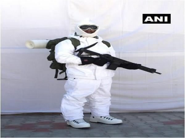 A soldier wearing American extreme cold weather clothing and carrying a Sig Sauer assault rifle. Photo/ANI