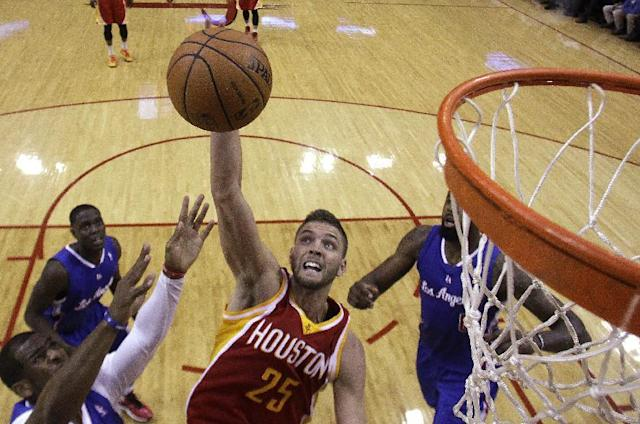Houston Rockets forward Chandler Parsons (25) takes a shot during the first half of an NBA basketball game against the Los Angeles Clippers, Saturday, March 29, 2013, in Houston. (AP Photo/Patric Schneider)