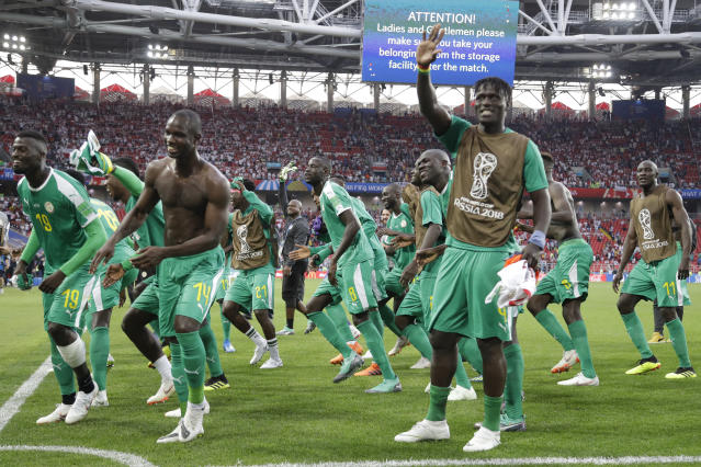 Senegal's team players celebrate as they won the group H match between Poland and Senegal at the 2018 soccer World Cup in the Spartak Stadium in Moscow, Russia, Tuesday, June 19, 2018. (AP Photo/Andrew Medichini)