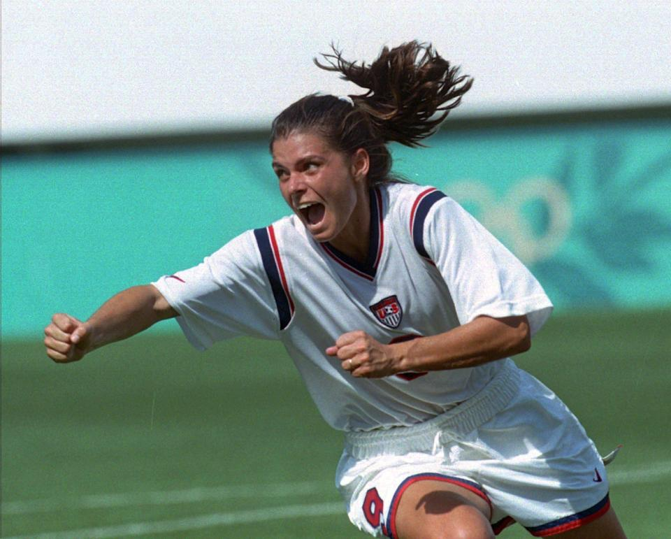 July 21, 1996: Mia Hamm celebrates after scoring a goal against Denmark at the Florida Citrus Bowl in Orlando, Fla. during the 1996 Olympics. The U.S. beat Denmark, 3-0, in the first game of the women's soccer tournament and would go on to win the gold medal.