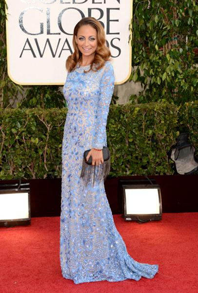 """<div class=""""caption-credit""""> Photo by: Getty Images</div><div class=""""caption-title""""></div><b>BEST: Nicole Richie</b> <br> Richie is one of our biggest style icons, and she looked beyond gorgeous in this blue, beaded Naeem Khan dress. And for those who think blue eye shadow can never work? Ha, you're wrong."""