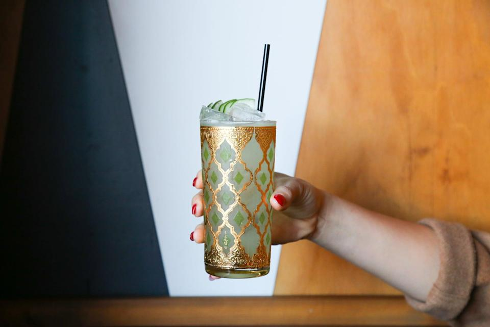 """<p>Believe it or not, the Umbrella cocktail - an invention by San Diego's <a href=""""http://www.madisononpark.com/"""" class=""""link rapid-noclick-resp"""" rel=""""nofollow noopener"""" target=""""_blank"""" data-ylk=""""slk:Madison on Park"""">Madison on Park</a> bar - has fewer than 100 calories in it, and it's incredibly tasty! </p> <p><strong>Ingredients: </strong></p> <ul> <li>Half a cucumber</li> <li>0.5 oz. simple syrup</li> <li> 1 oz. lemon juice</li> <li> 2 oz. Green Chile Vodka </li> </ul> <p><strong>Directions: </strong>Cut your cucumber into thin slices, and muddle three to five slices with your simple syrup in a shaker. Add lemon juice and vodka, shake well, then strain over ice into a beautiful glass. Garnish with three fanned cucumber slices. </p>"""