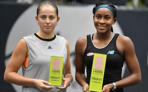 <span>Ostapenko and Gauff pose with their respective trophies</span> <span>Credit: afp </span>