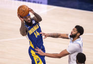Indiana Pacers forward JaKarr Sampson (14) passes the ball to a teammate during the second half of an NBA basketball game against the Los Angeles Lakers in Indianapolis, Saturday, May 15, 2021. (AP Photo/Doug McSchooler)