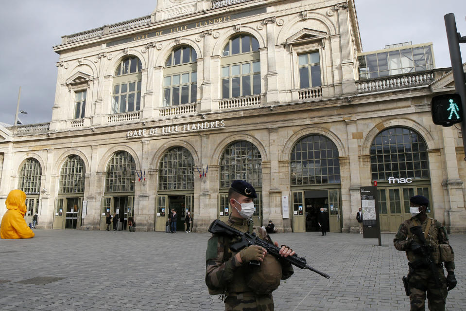 French soldiers patrol next to the station in Lille northern France, Friday, Oct. 30, 2020. France re-imposed a monthlong nationwide lockdown Friday aimed at slowing the spread of coronavirus, closing all non-essential business and forbidding people from going beyond one kilometer from their homes except to go to school or a few other essential reasons. (AP Photo/Michel Spingler)