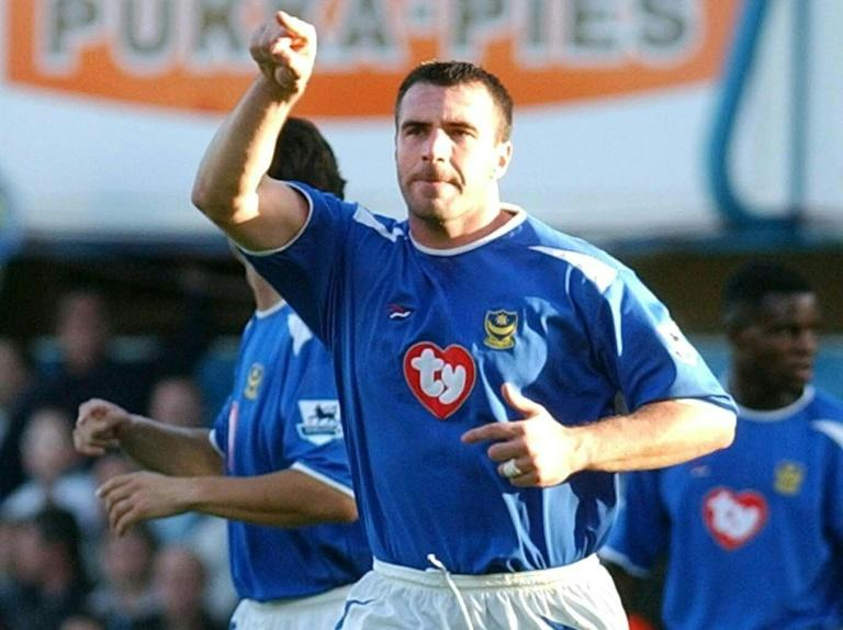 David Unsworth, then with Portsmouth, celebrates after scoring a penalty against Manchester United during a game on October 30, 2004 in Portsmouth, southern England