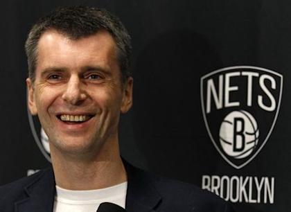 Mikhail Prokhorov wants, and now has, the whole thing. (REUTERS/Adam Hunger)