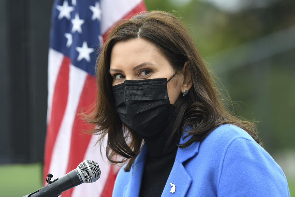Michigan Governor Gretchen Whitmer U.S. talks about the statewide COVID-19 vaccination effort during a press conference outside the Eastern Michigan University Convocation Center, which was hosting a vaccination clinic, Monday, April 12, 2021, in Ypsilanti, Mich. (Lon Horwedel/Detroit News via AP)