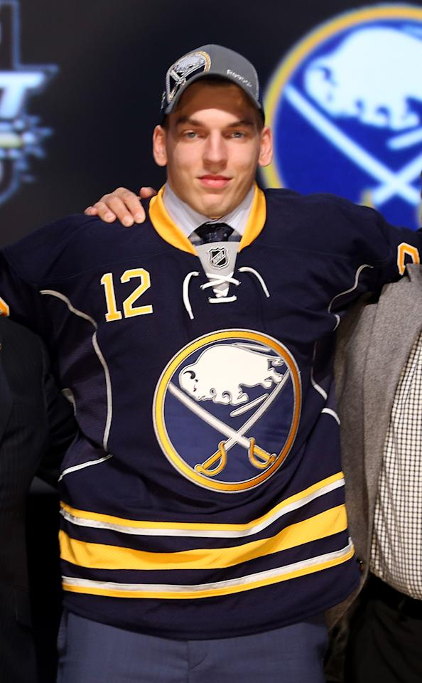 PITTSBURGH, PA - JUNE 22: Zemgus Girgensons, 14th overall pick by the Buffalo Sabres, poses on stage during Round One of the 2012 NHL Entry Draft at Consol Energy Center on June 22, 2012 in Pittsburgh, Pennsylvania.  (Photo by Bruce Bennett/Getty Images)