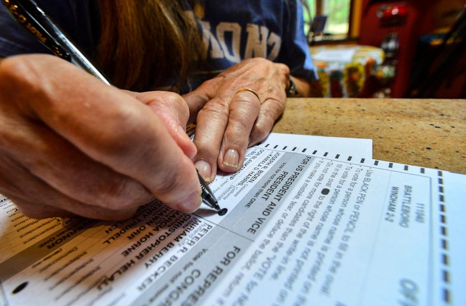 Susan Avery of Brattleboro, Vt., fills out the ballot she received in the mail on Sept. 28.