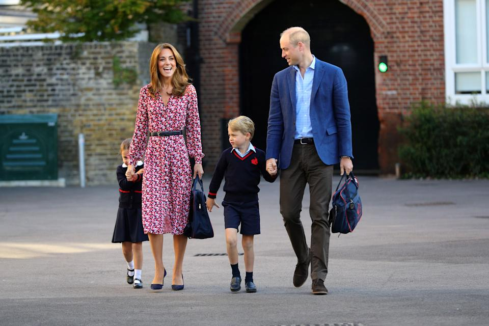 Britain's Princess Charlotte of Cambridge, accompanied by her father, Britain's Prince William, Duke of Cambridge, her mother, Britain's Catherine, Duchess of Cambridge and her brother, Britain's Prince George of Cambridge,arrives for her first day of school at Thomas's Battersea in London on September 5, 2019. (Photo by Aaron Chown / POOL / AFP)        (Photo credit should read AARON CHOWN/AFP/Getty Images)