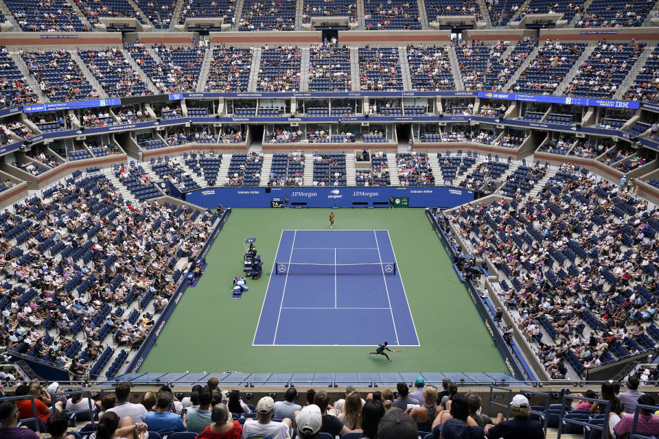 Sloane Stephens, of the United States, returns a shot to Madison Keys, of the United States, during the first round of the US Open tennis championships, Monday, Aug. 30, 2021, in New York. (AP Photo/Seth Wenig)