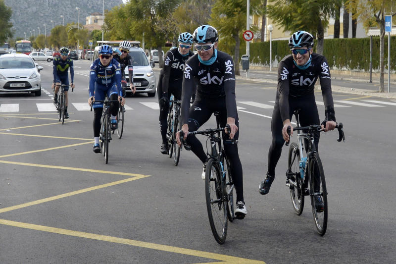 Britain's Chris Froome, centre, arrives back at his hotel after training in Palma de Mallorca, Spain, Wednesday Dec. 13, 2017. Froome failed a doping test during the Spanish Vuelta in September and is facing a suspension from cycling ahead of his attempt to win a record-equaling fifth Tour de France title next year. (AP Photo/Joan Llado)