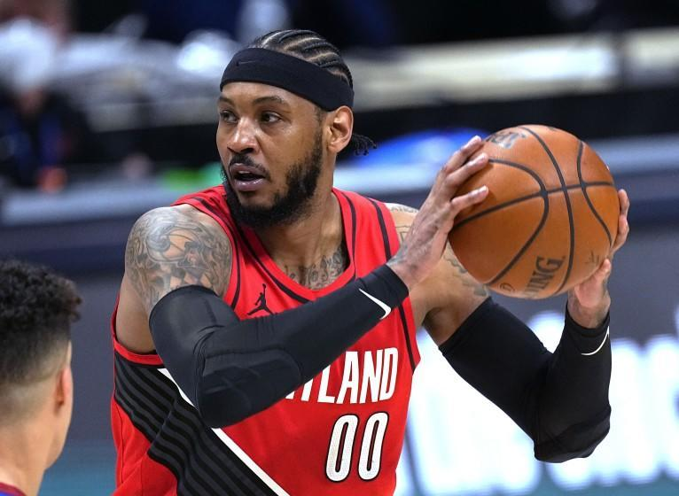 Portland Trail Blazers forward Carmelo Anthony looks to pass the ball against the Denver Nuggets.