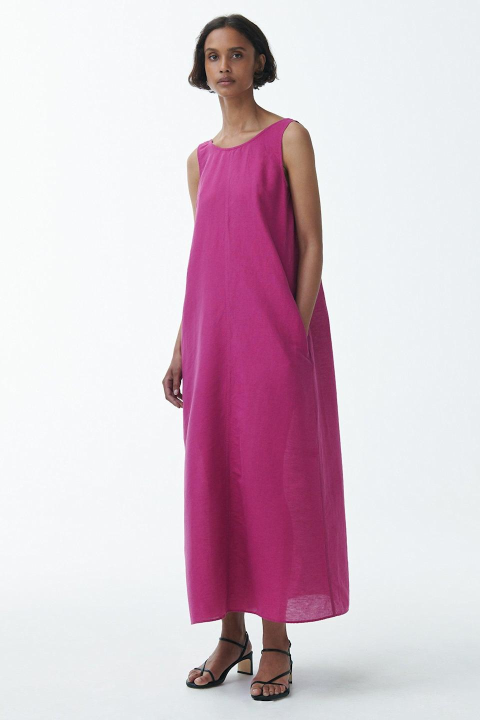 """We pulled this bright, beautiful maxi dress out of COS's latest linen edit — the demure front belies a dangerously plunging back that gives this modest silhouette a sensual boost. There's plenty more linen where this came from, all rendered with COS's signature Scandi-flavored restraint. <br><br><em>Shop linen at <strong><a href=""""https://www.cosstores.com/en_usd/women/the-edit.html"""" rel=""""nofollow noopener"""" target=""""_blank"""" data-ylk=""""slk:COS"""" class=""""link rapid-noclick-resp"""">COS</a></strong></em><br><br><strong>COS</strong> Exposed Back Maxi Dress, $, available at <a href=""""https://go.skimresources.com/?id=30283X879131&url=https%3A%2F%2Fwww.cosstores.com%2Fen_usd%2Fwomen%2Fwomenswear%2Fdresses%2Fproduct.linen-exposed-back-maxi-dress-purple.0895246001.html"""" rel=""""nofollow noopener"""" target=""""_blank"""" data-ylk=""""slk:COS"""" class=""""link rapid-noclick-resp"""">COS</a><br><br>"""