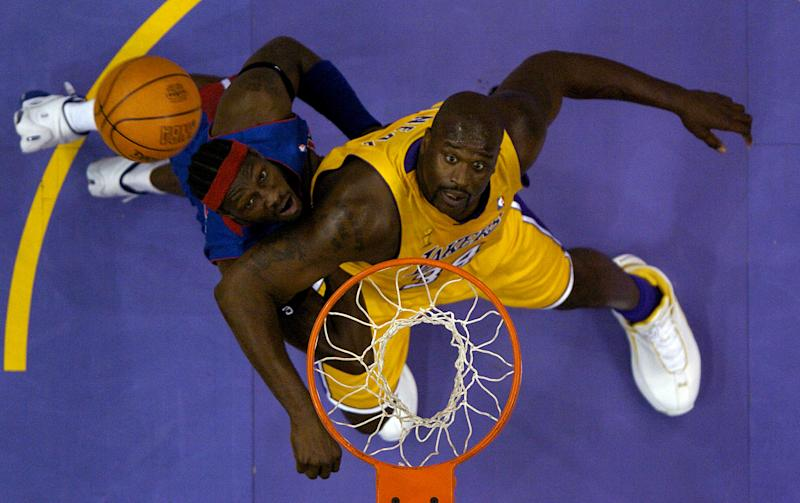 Ben Wallace and Shaquille O'Neal had multiple playoff battles in their careers. (Getty Images)