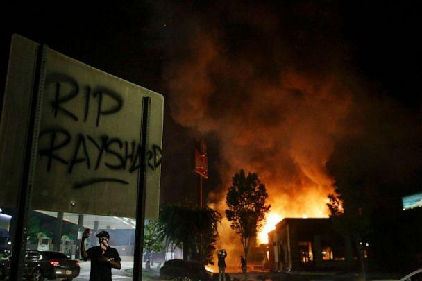 PHOTO: Flames engulf a Wendy's restaurant during protests in Atlanta, June 13, 2020. The restaurant was where Rayshard Brooks was shot and killed by police the previous evening. (Brynn Anderson/AP)