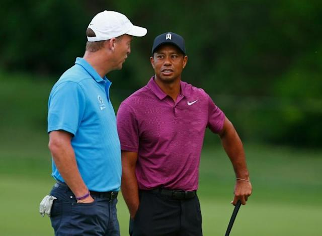 Tiger Woods and Peyton Manning chat during the 2018 Memorial Tournament pro-am, the two will team up to take on Phil Mickelson and Tom Brady in a charity match for COVID-19 relief (AFP Photo/Matt SULLIVAN)
