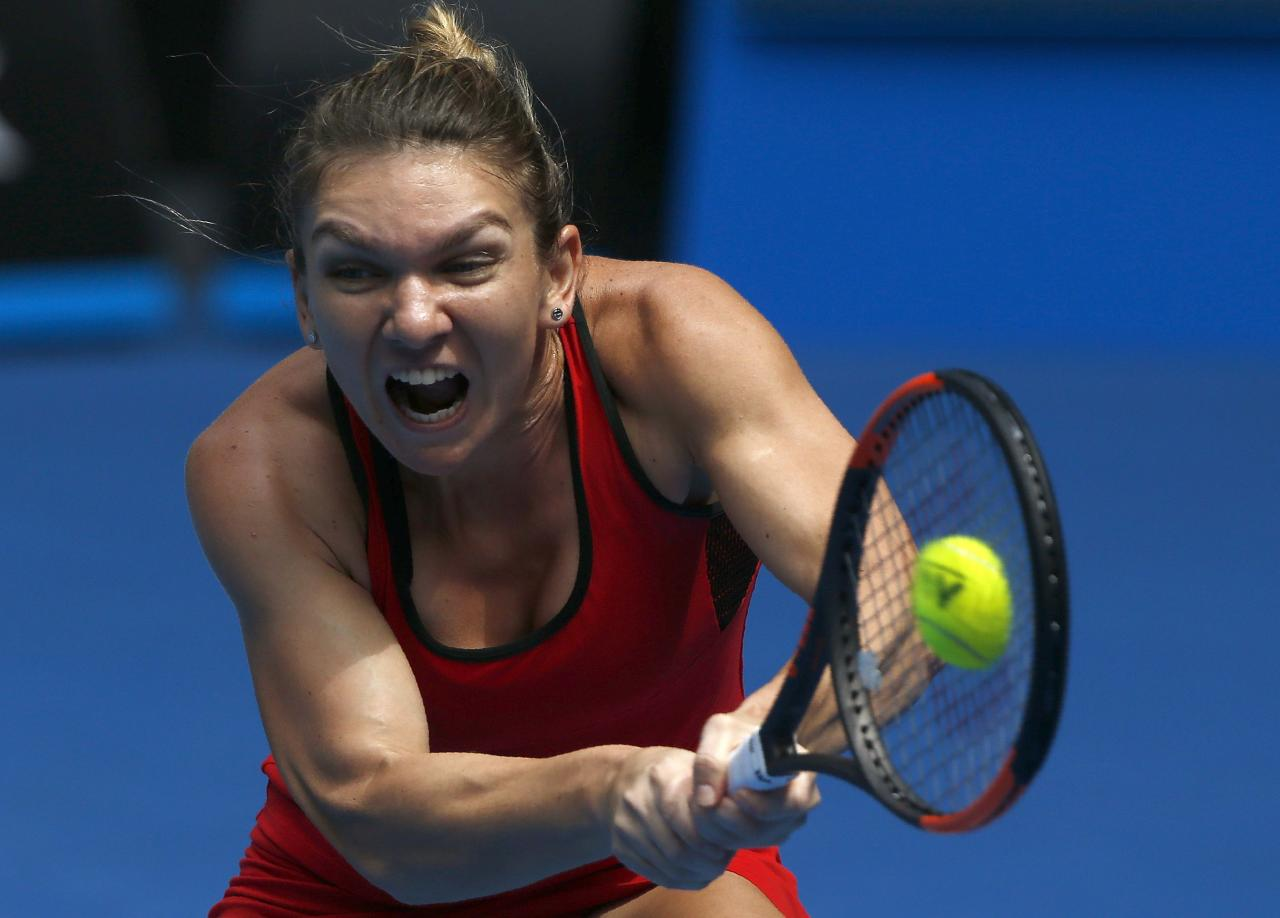 Tennis - Australian Open - Rod Laver Arena, Melbourne, Australia, January 20, 2018. Simona Halep of Romania hits a shot against Lauren Davis of the U.S. REUTERS/Thomas Peter