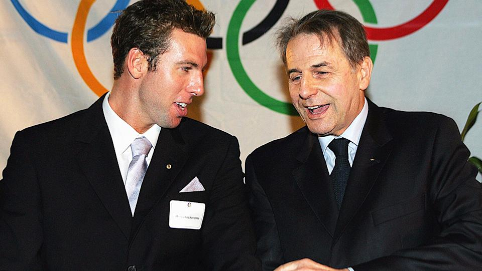 Jacques Rogge, pictured here with Australian swimming great Grant Hackett in 2005.