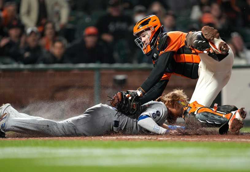 SAN FRANCISCO, CALIFORNIA - SEPTEMBER 03: Buster Posey #28 of the San Francisco Giants tags out Justin Turner.