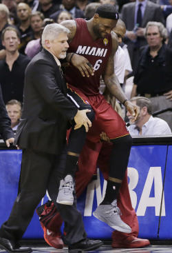 LeBron James had to be helped to the bench in the fourth quarter. (AP)