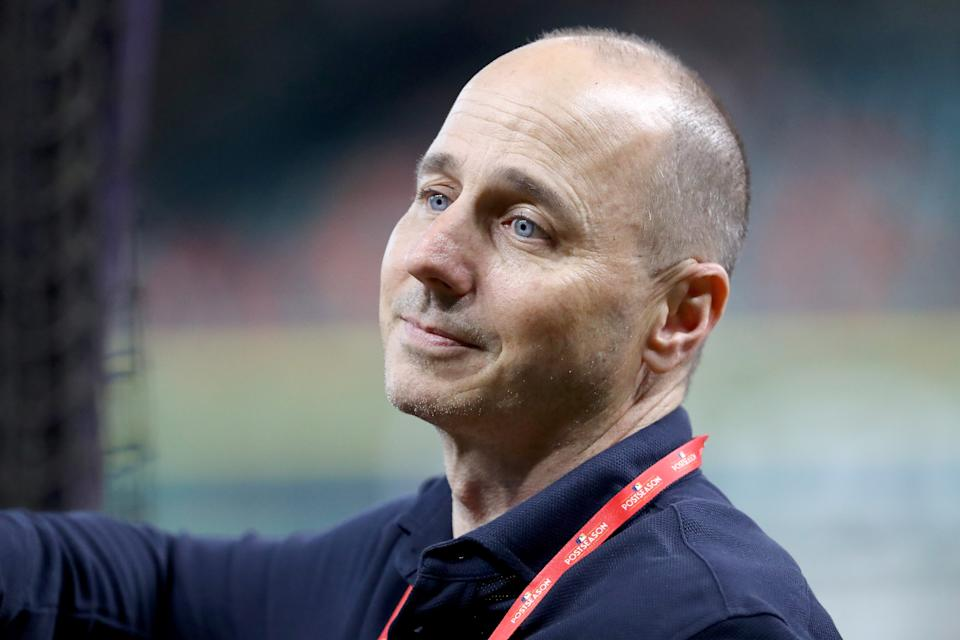 Police body cam shows brief but tense confrontation as Connecticut officers draw guns on Yankees GM Brian Cashman. (Photo by Elsa/Getty Images)