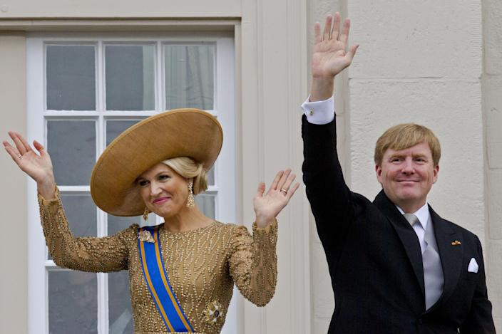 Netherlands' King Willem-Alexander and his wife Queen Maxima wave to well wishers from the balcony of Noordeinde Palace, after the King officially opened the new parliamentary year with a speech outlining the government's plan and budget policies for the year ahead in The Hague, Netherlands, Tuesday, Sept. 17, 2013. (AP Photo/Peter Dejong)