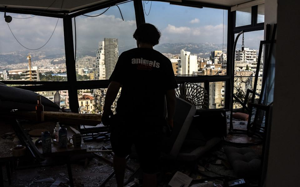 Animals Lebanon's lead pet catcher searches for a cat in a blast devastated appartment in the Skyline Tower opposite the Port of Beirut - Elizabeth Fitt /© EF Images 2020
