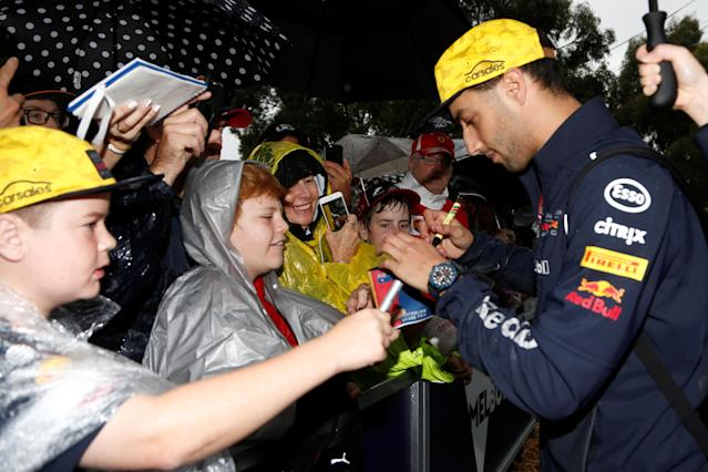 Formula One F1 - Australian Grand Prix - Melbourne Grand Prix Circuit, Melbourne, Australia - March 24, 2018 Red Bull's Daniel Ricciardo signs autographs for fans REUTERS/Brandon Malone