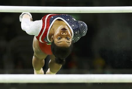 2016 Rio Olympics - Artistic Gymnastics - Final - Women's Team Final - Rio Olympic Arena - Rio de Janeiro, Brazil - 09/08/2016. Gabrielle Douglas (USA) of USA (Gabby Douglas) competes on the uneven bars during the women's team final. REUTERS/Mike Blake